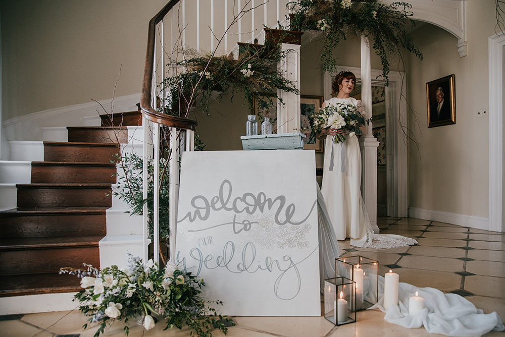 Stairs Staircase Flower Installation Greenery Foliage Arrangement Sign Signage Blue Wedding Ideas Emma McNair Photography