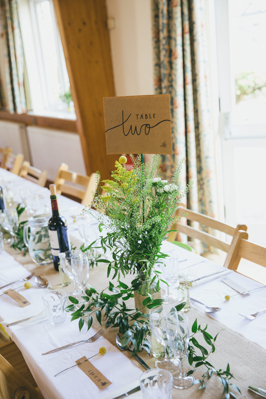 Yellow Bottle Flowers Centrepiece Table Number Damerham Village Hall Wedding Lisa-Marie Halliday Photography