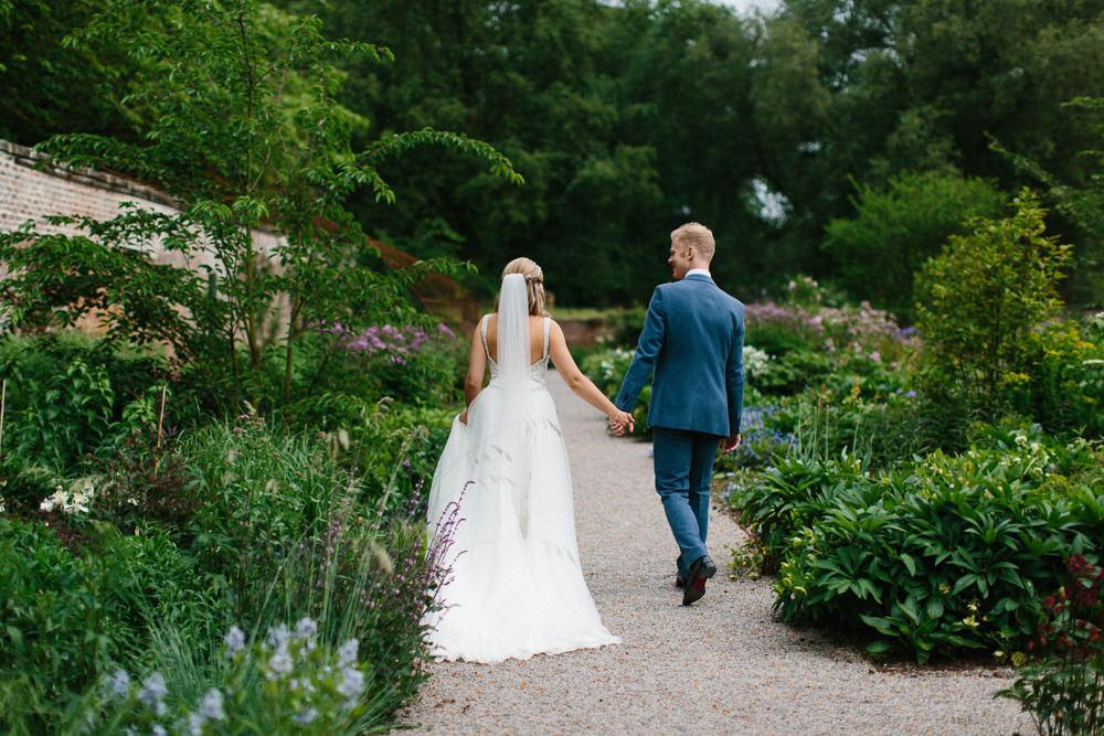 Bride Bridal Dress Sleeveless A Line Beaded Embellished V Neck Tiara Blue Suit Waistcoat Groom Veil Garden Ceremony Wedding Melissa Beattie Photography