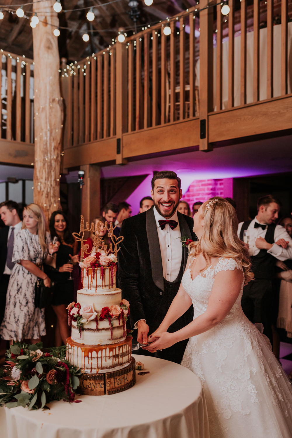 Bride Bridal Cap Sleeve Lace Overlay Dress Gown Velvet Tuxedo Burgundy Bow Tie Groom Drip Cake Cutting Gaynes Park Wedding Kate Gray Photography