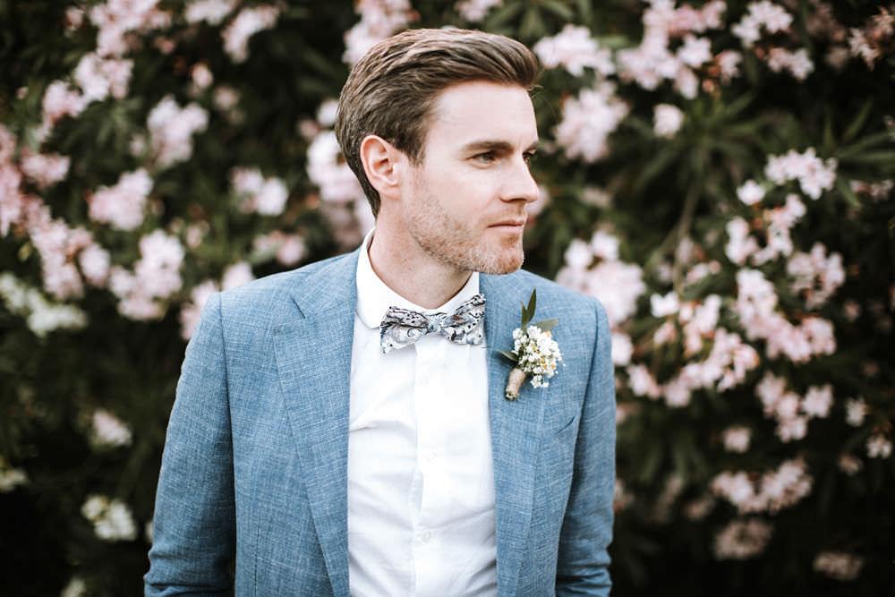Blue Suit Groom Floral Bow Tie Portugal Destination Wedding Ana Parker Photography