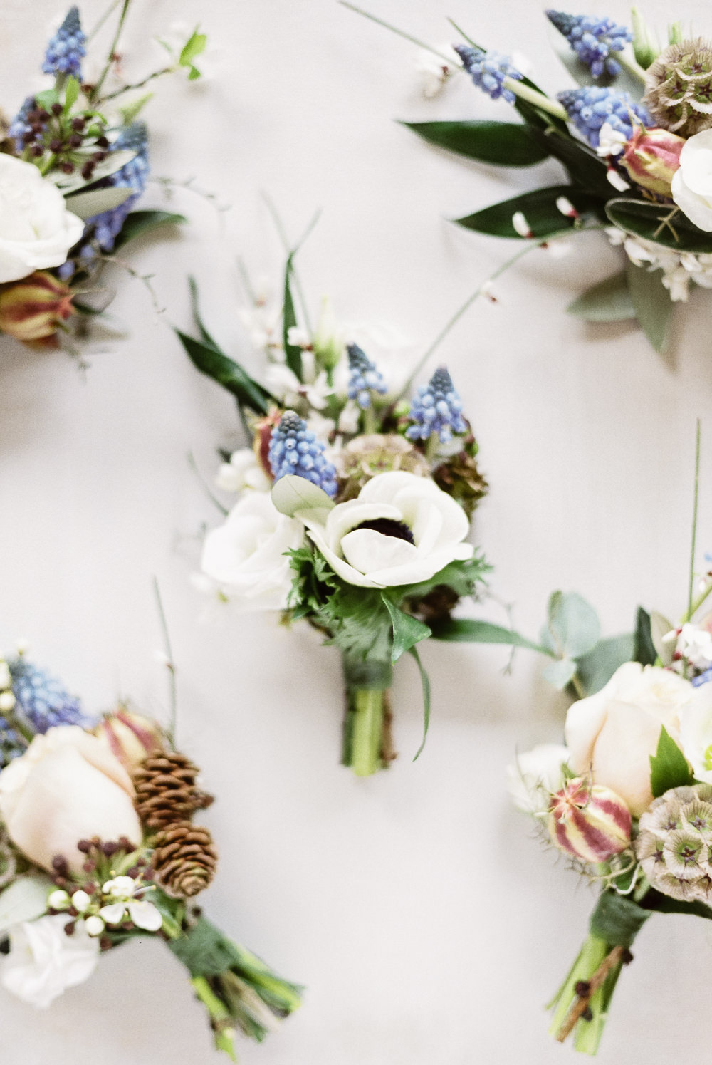 Buttonhole Flowers Grape Hyacinth Anemone Pine Cones Winter Blue Barn Wedding Ideas Joanna Briggs Photography