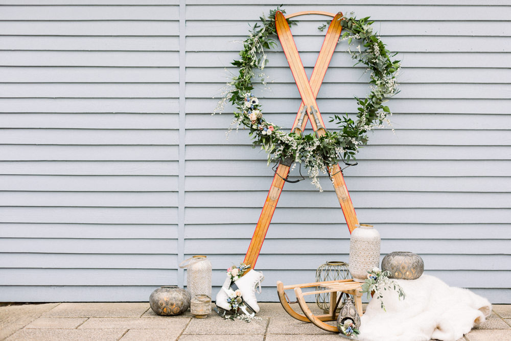 Wreath Hoop Greenery Sledge Ice Skates Flowers Winter Blue Barn Wedding Ideas Joanna Briggs Photography