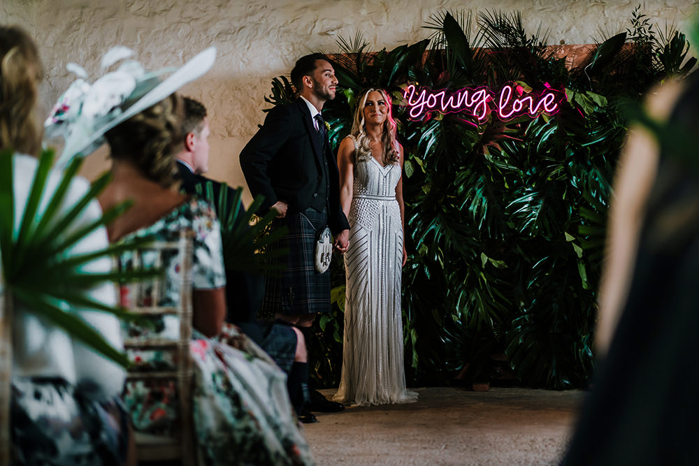 Bride Bridal Beaded Embellished V Neck Dress Gown Succulents Bouquet Kilt Groom Greenery Backdrop Ceremony Young Love Neon Tropical Luxe Wedding Burfly Photography