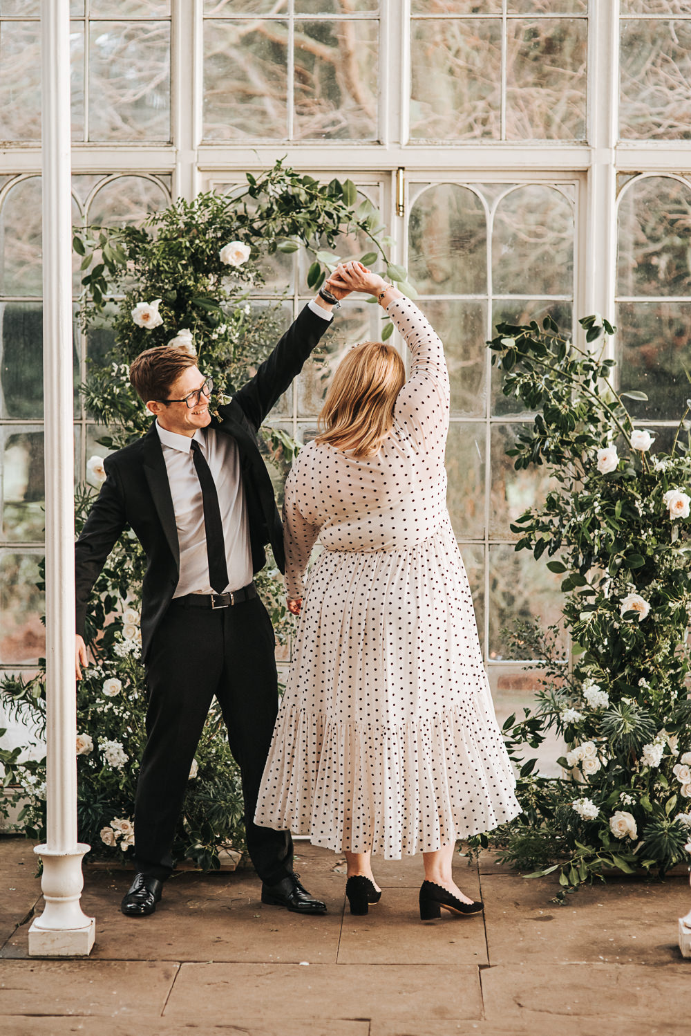 Flower Arch Installation Backdrop Ceremony Aisle Greenery Foliage Rose Wild Natural Wollaton Hall Wedding Pear and Bear Photography