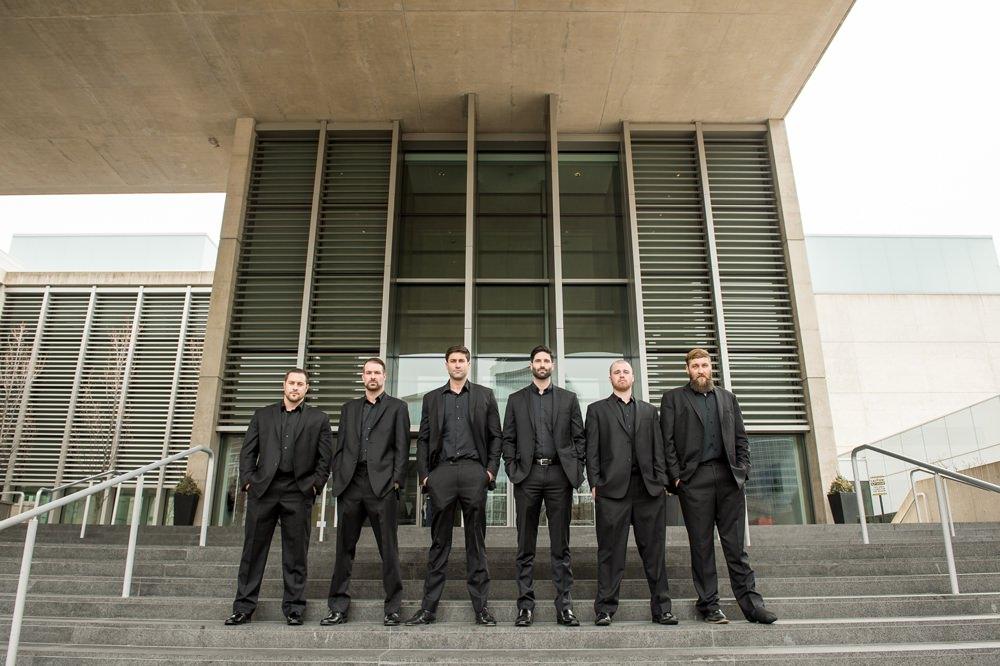 Groom Black Suit Tie Shirt Open Collar Groomsmen Greenhouse Michigan Wedding Jean Smith Photography