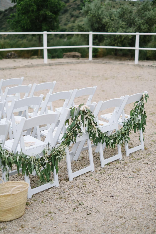 Chair Flowers Greenery Foliage Swag Garland Spain Destination Wedding Jesus Caballero Photography