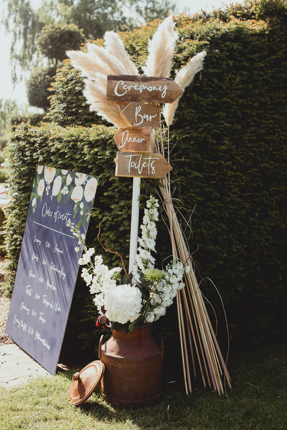 Wooden Sign Post Direction Pampas Grass Order of Day Weekend Long Wedding Georgia Rachael Photography