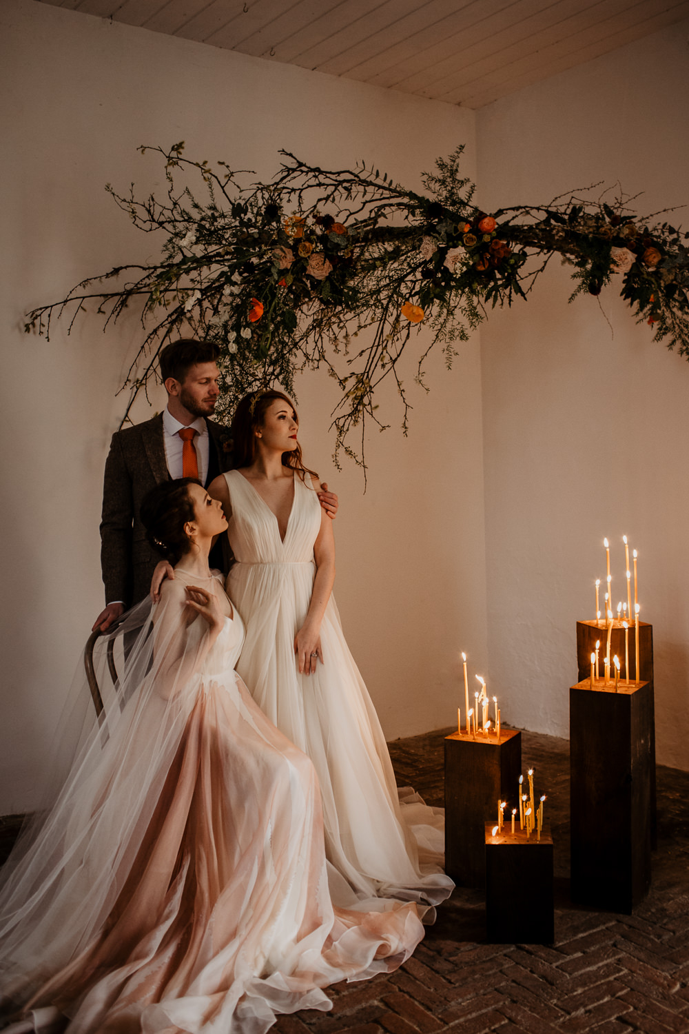 Elopement Wedding Ideas Oilvejoy Photography Branch Installation Flowers Wild Natural Orange Rose Autumn Fall Candles Backdrop Floral