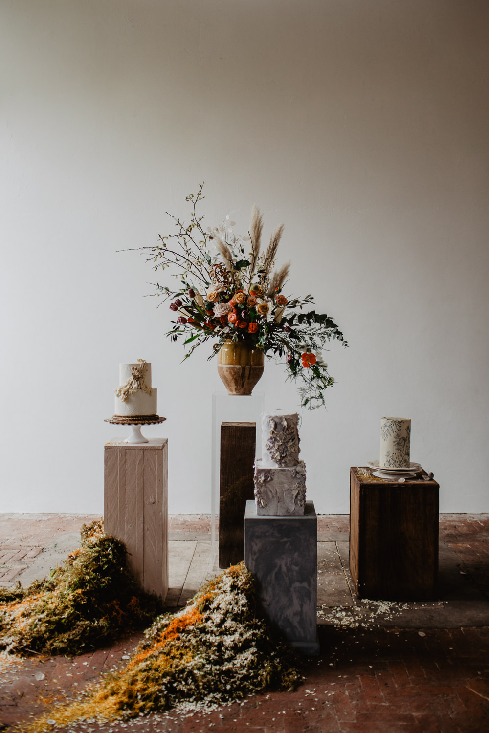 Cake Table Dessert Cakes Dried Flowers Pottery Fabric Earthy Natural Plinths Moss Confetti Installation Flowers Vase Elopement Wedding Ideas Oilvejoy Photography