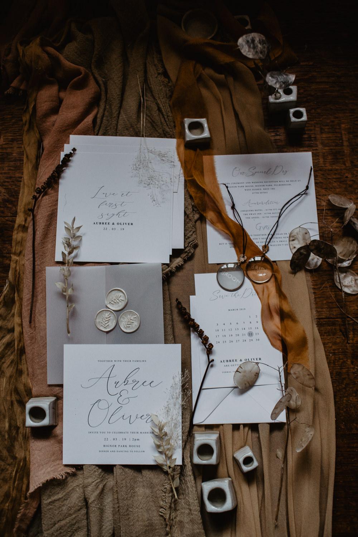 Stationery Invite Invitations Silks Fabric Burnt Orange Fall Autumn Calligraphy Grey Wax Seal Flat Lay Elopement Wedding Ideas Oilvejoy Photography