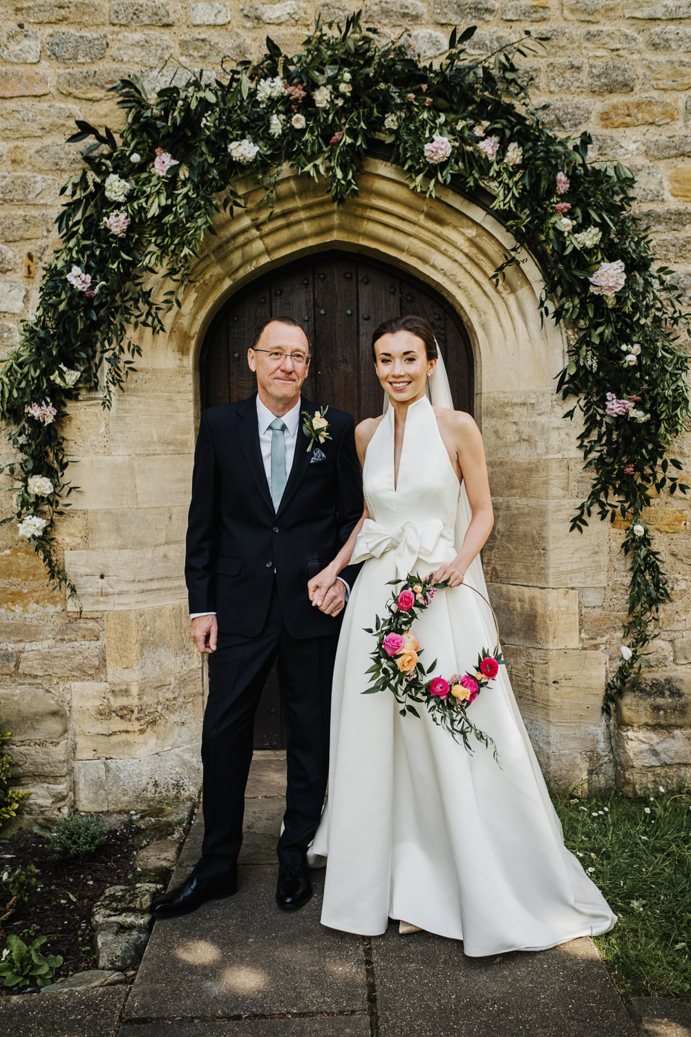 Bride Bridal Halterneck Collar Dress Gown Pockets Bow Jesus Peiro Floral Hoop Veil Greenery Floral Church Arch Middlethorpe Hall Wedding Andy Withey Photography
