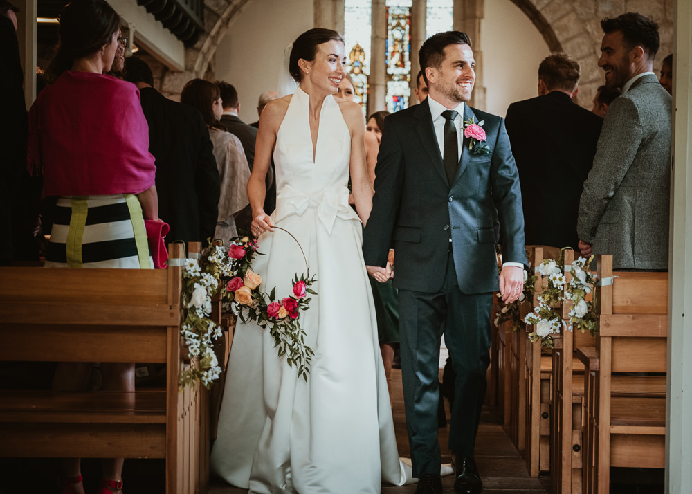Bride Bridal Halterneck Collar Dress Gown Pockets Bow Jesus Peiro Navy Suit Groom Floral Hoop Middlethorpe Hall Wedding Andy Withey Photography