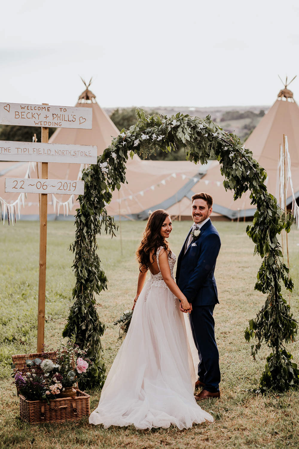 Village Tipi Wedding Ryan Goold Photography Greenery Foliage Arch Flower Sign Signs Signage SignPost