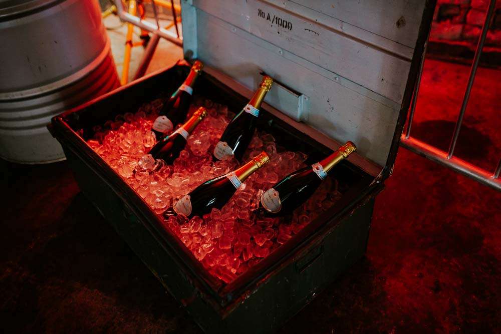 Crate Suitcase Chest Drinks Bottles Neon Sign Wedding Ideas State Of Love and Trust Photography
