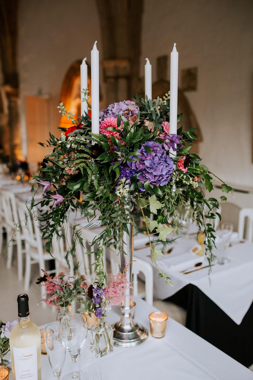 Candelabra Flowers Centrepiece Greenery Foliage Hydrangea Butley Priory Wedding Sally Rawlins Photography