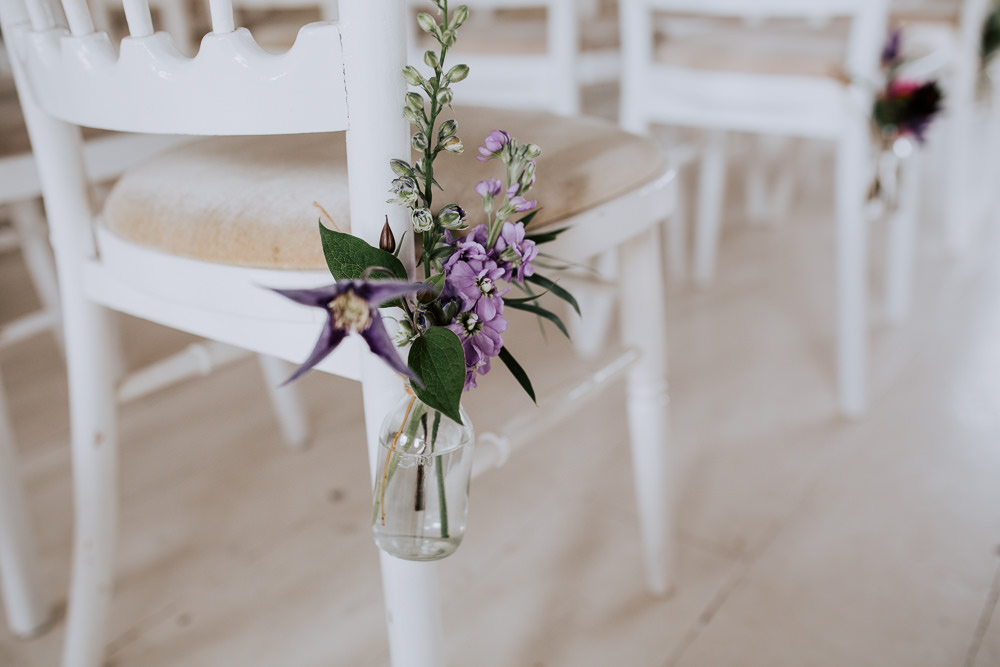 Pew End Chair Aisle Flowers Bottle Purple Lilac Butley Priory Wedding Sally Rawlins Photography