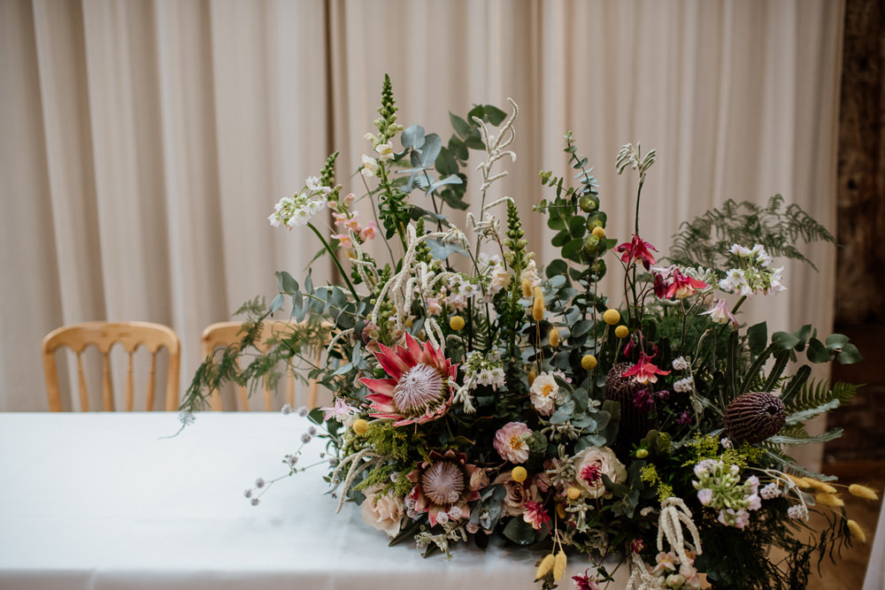 Table Flowers Arrangement King Protea Greenery Foliage Wild Henry Moore Wedding Ellie Gillard Photography