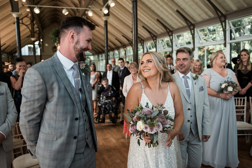 Bride Bridal Strappy Sparkly Sequin V Neck White ASOS Dress Gown Grey Checked Suit Three Piece Waistcoat Groom Bouquet Hexham Winter Gardens Wedding Leighton Bainbridge Photography