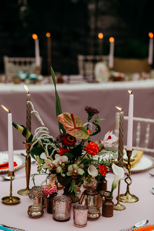 Flower Arrangement Candles Centrepiece Metal Palm Leaf Birds of Paradise Protea Hanging Orchids Anthurium Tropical Wedding Ideas When Charlie Met Hannah