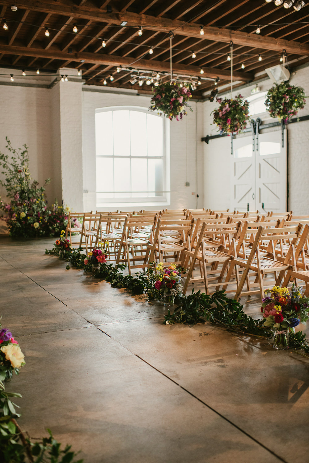 Ceiling Hanging Suspended Flowers Decor Spring Coral Peony Natural Wild Colourful Aisle Riverside London Wedding Ellie Gillard Photography