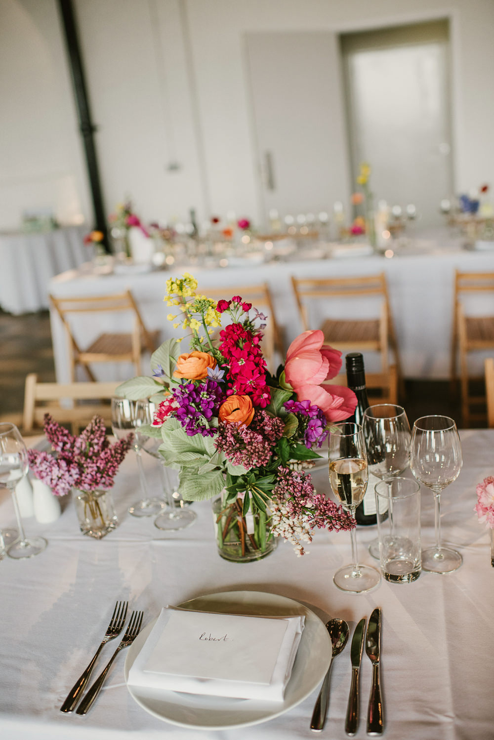 Bottle Flowers Table Decor Centrepiece Spring Coral Peony Natural Wild Colourful Riverside London Wedding Ellie Gillard Photography