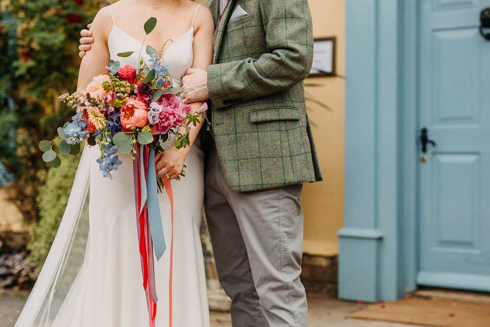 Bouquet Flowers Bride Bridal Coral Peony Peonies Pink Rose Ribbons Delphinium Hydrangea South Farm Wedding Miracle Moments