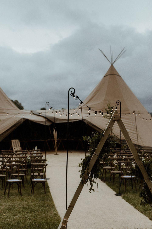Tipi Festoon Lights Ceremony Reception Outdoor Wedding UK Olivia and Dan Photography