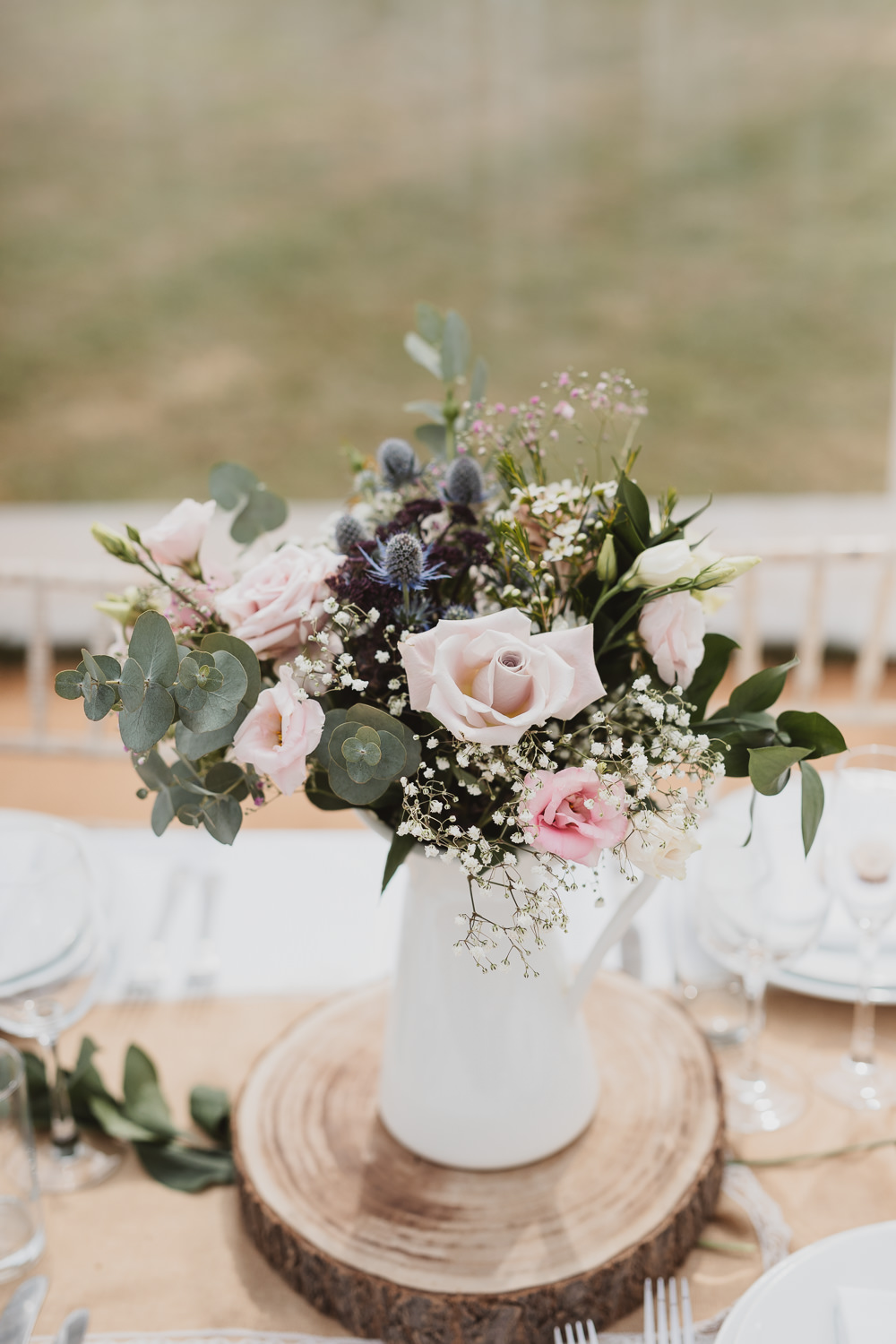 Flowers Jug Rose Thistle Eucalyptus Log Slice Centrepiece Clear Marquee Wedding Sarah Brookes Photography