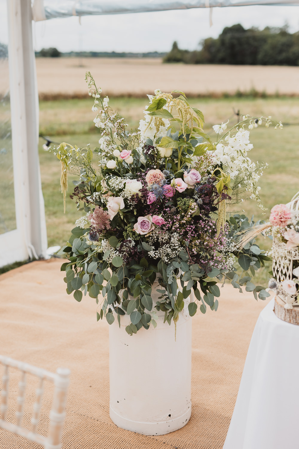 Flower Arrangement Tall Wild Natural Pretty Clear Marquee Wedding Sarah Brookes Photography