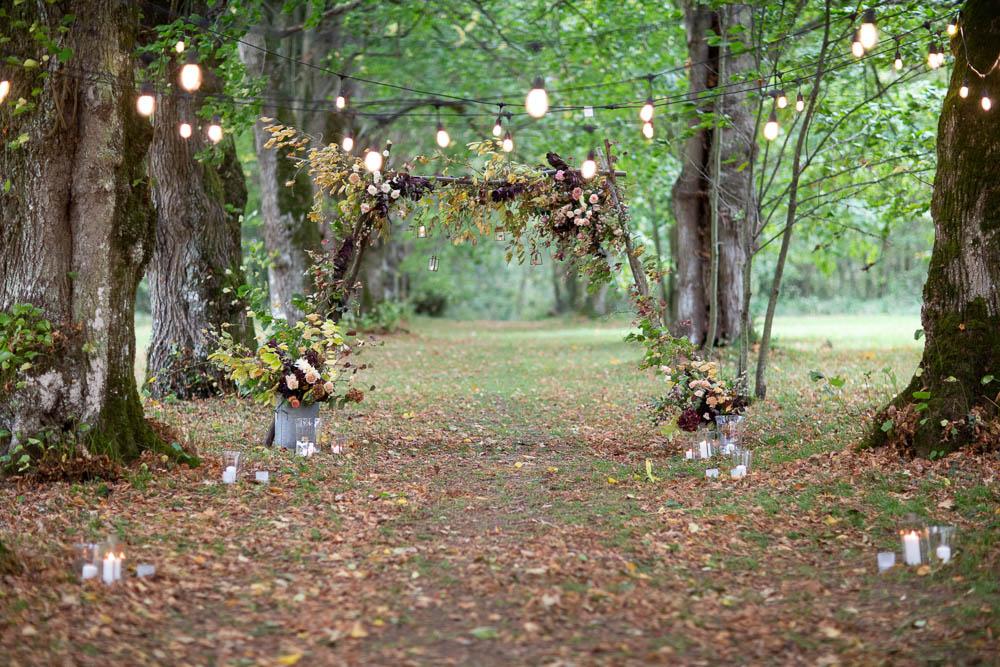Flower Arch Backdrop Ceremony Woodland Trees Festoon Lights Château Elopement France Maru Photography