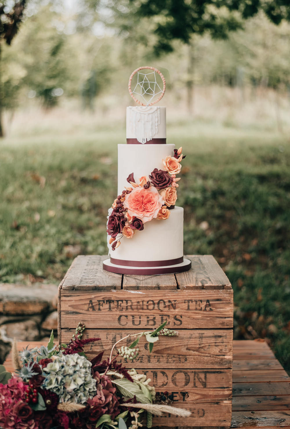 Iced Cake Sugar Flowers Dream Catcher Macrame Burgundy Orange Wooden Crates Stand Eco Friendly Wedding Inspiration Sarah Jayne Photography