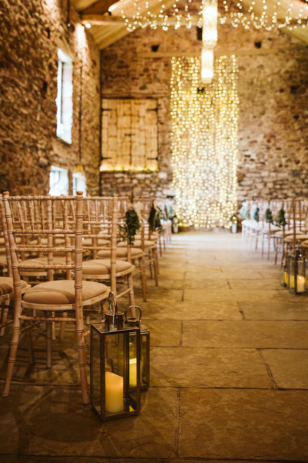 Aisle Ceremony Chairs Lanterns Pew End Flowers Fairy Light Backdrop Eden Barn Wedding Margarita Hope Photography
