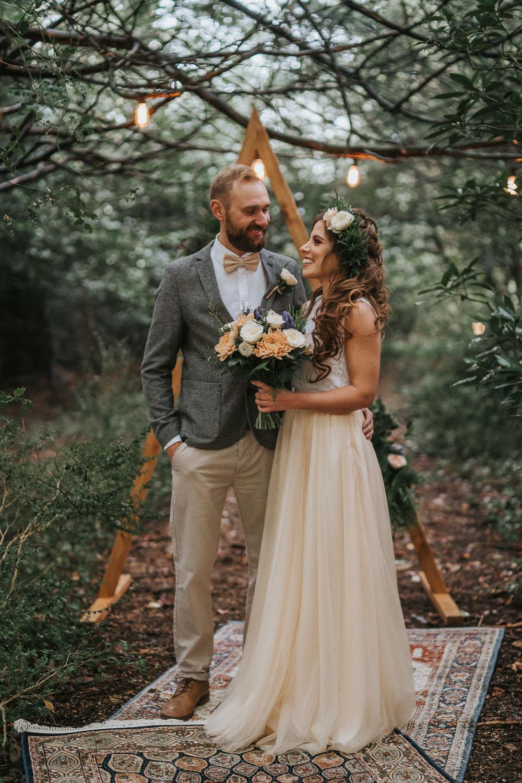 Woodland Wedding Inspiration Stephanie Dreams Photography Backdrop Triangle Wooden Festoon Lights Rugs Ceremony Aisle