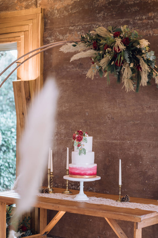 Moon Gate Flower Arch Cake Table Decadent Christmas Wedding Jessica Raphael Photography