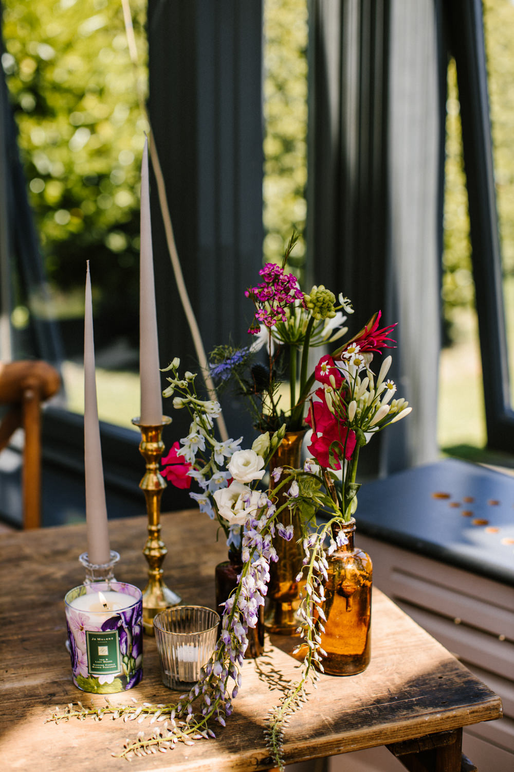Table Flowers Bottles Candles Decor Titchwell Manor Wedding Honey and The Moon Photography