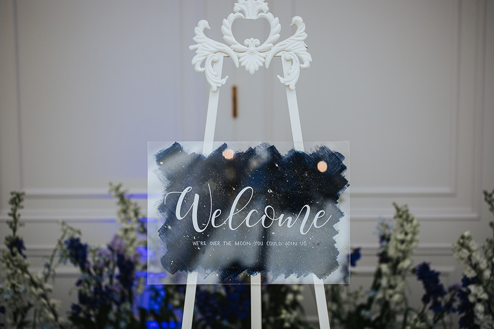 Welcome Sign Blue Celestial Flower Meadow Candles Moon Stars Wedding Ideas Olegs Samsonovs Photography