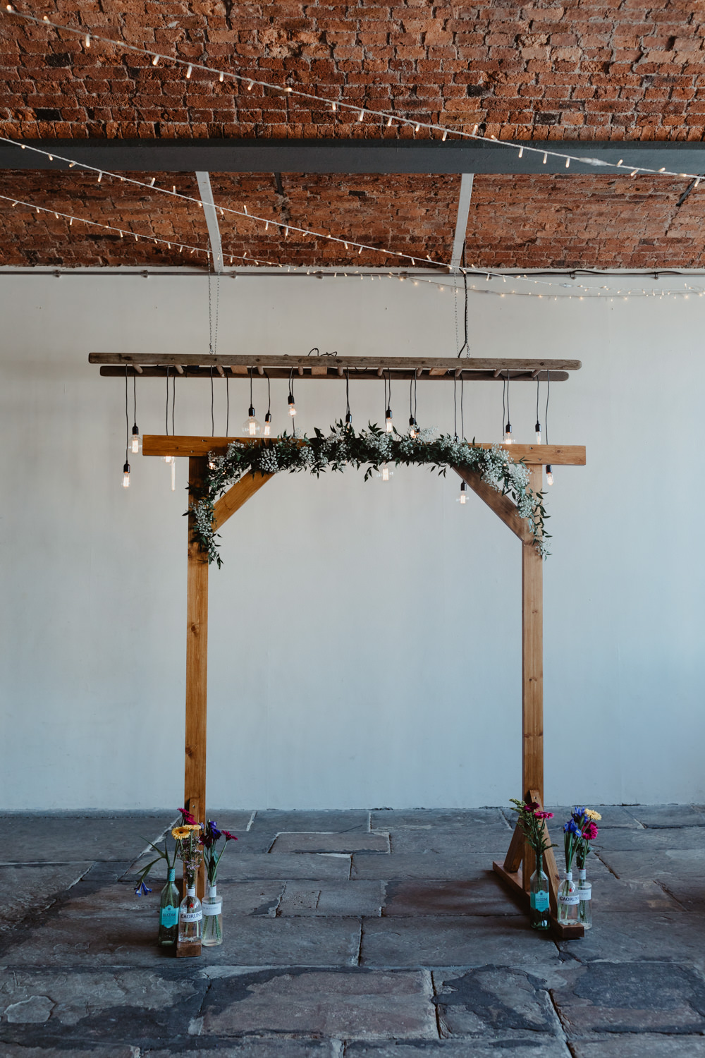 Wooden Frame Backdrop Arch Greenery Foliage Festoon Lights Edison Lighting Arches Dean Clough Wedding Stevie Jay Photography
