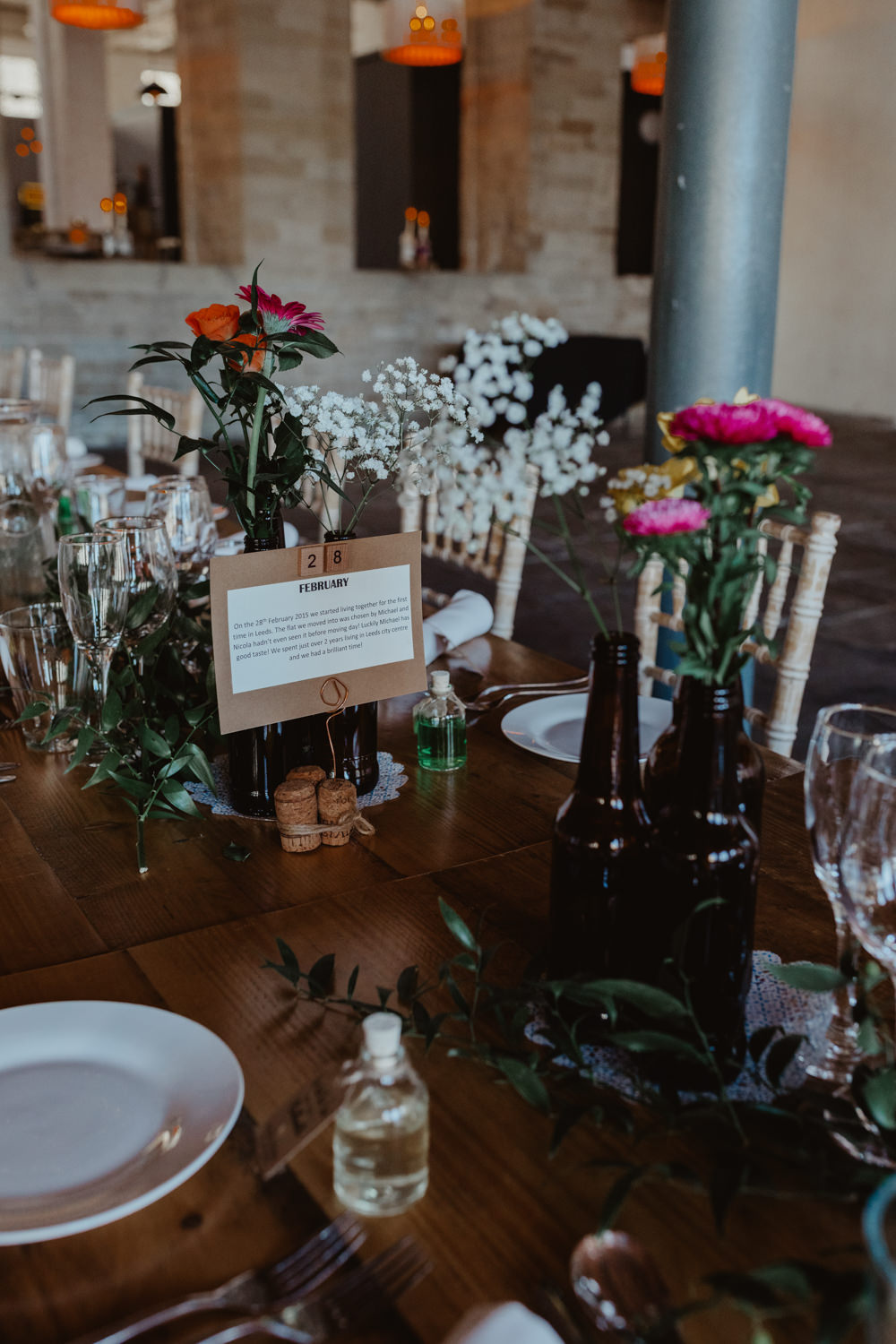 Table Decor Centrepiece Flowesr Bottle Flowers Arches Dean Clough Wedding Stevie Jay Photography