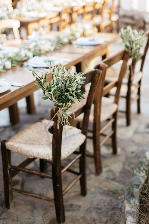 Chair Flowers Greenery Foliage Crete Wedding HannaMonika Wedding Photography