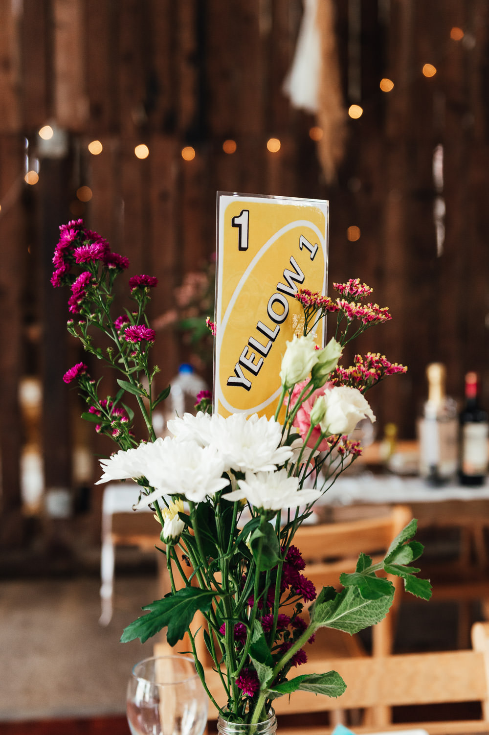 Table Flowers Decor Centrepiece Table Name Number Uno DIY Barn Wedding Jessica Grace Photography