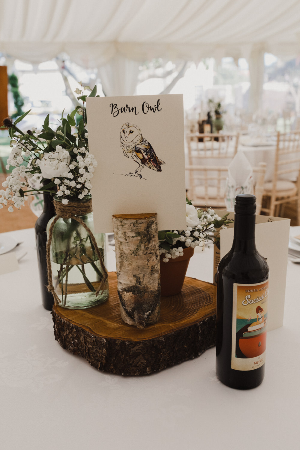 Table Centrepiece Log Slice Jar Flowers Animal Nature Table Names Seaside Wedding Oli and Steph Photography