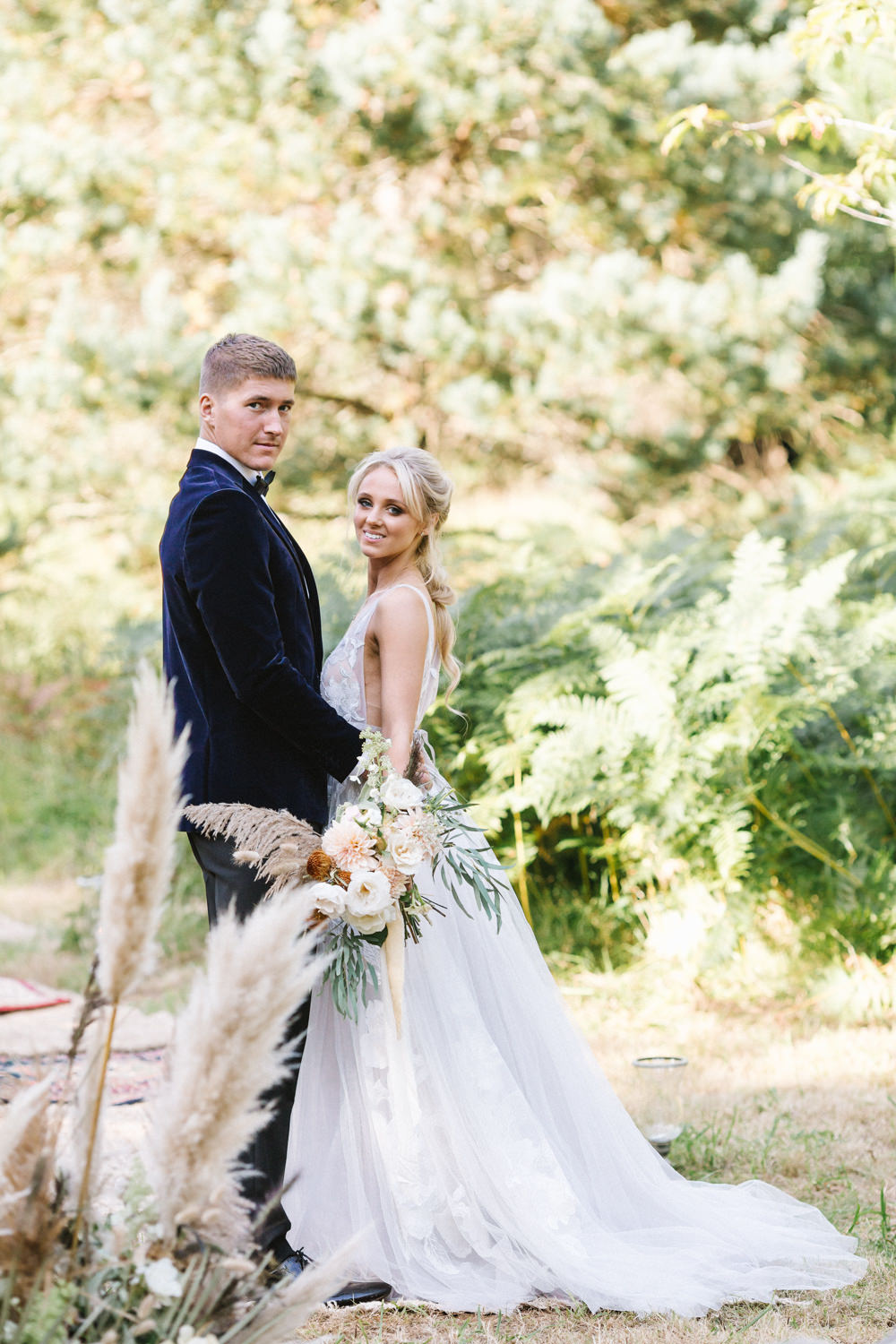 Ceremony Woodland Outdoor Circle Round Chairs Flowers Pampas Grass Palm Leaves Dahlias Aisle Dress Gown Bride Bridal Willowby Embroided Boconnoc Wedding Debs Alexander Photography