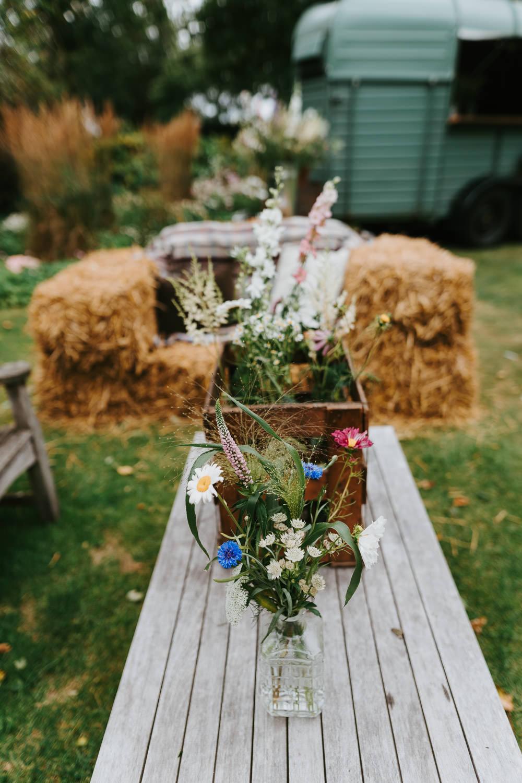 Garden Decor Flowers Hay Bales Country Festival Wedding Jonny Gouldstone Photography