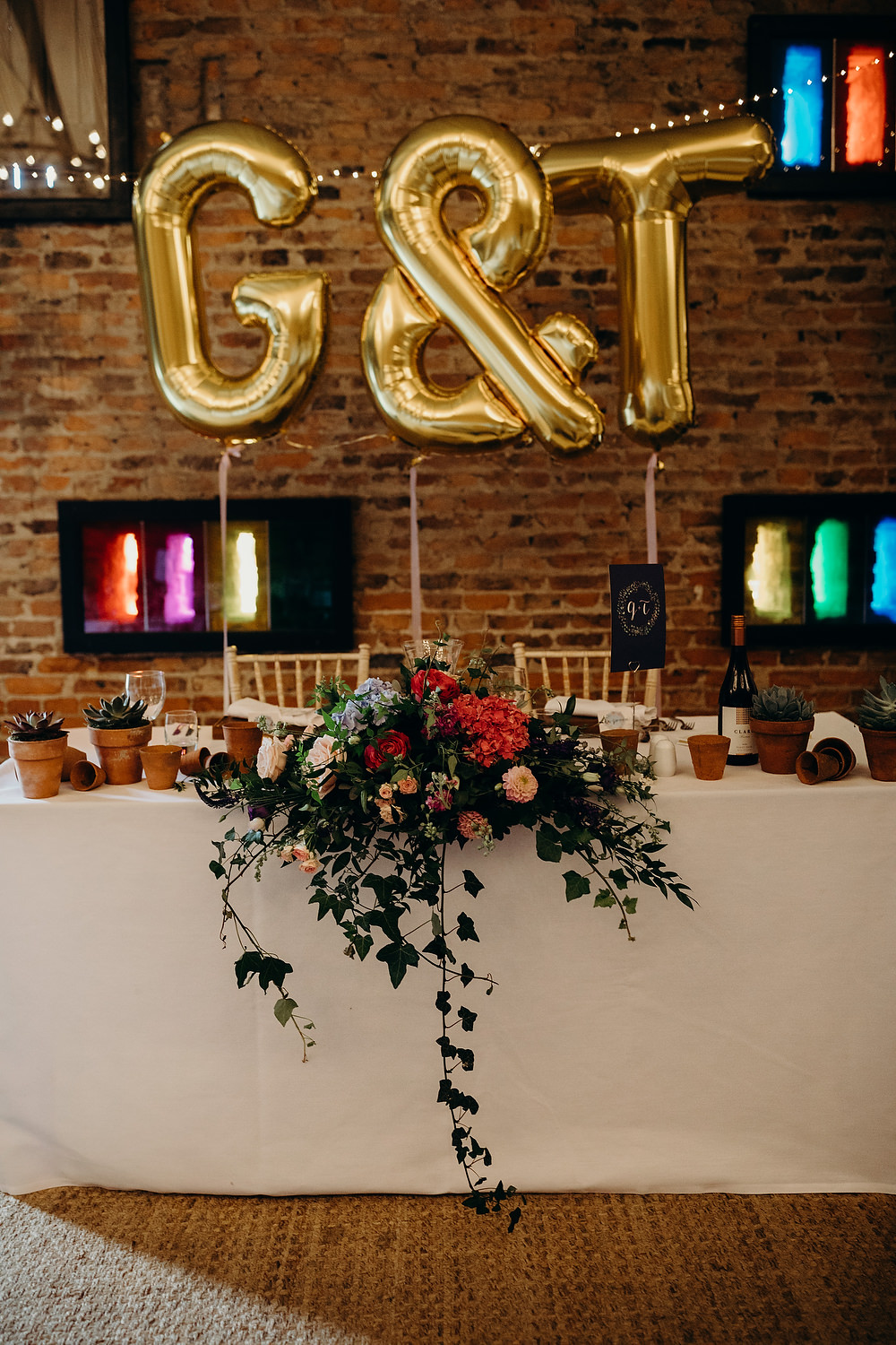 Top Table Flowers Giant Balloons Hornington Manor Wedding Richard Skins Photography