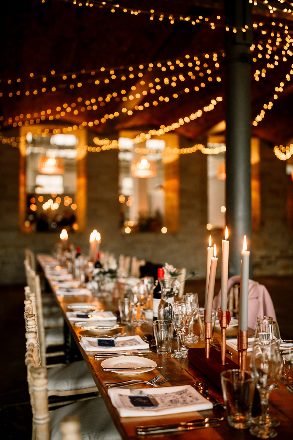 Arches in Halifax Warehouse Fairy Lights Long Tables Decor Industrial Mill Wedding Hayley Baxter Photography