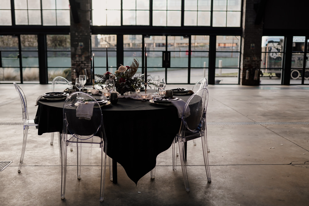 Table Tablescape Decor Black Table Cloth Candles Flowers Ghost Chairs Industrial Wedding Ideas Sam Sparks Photography