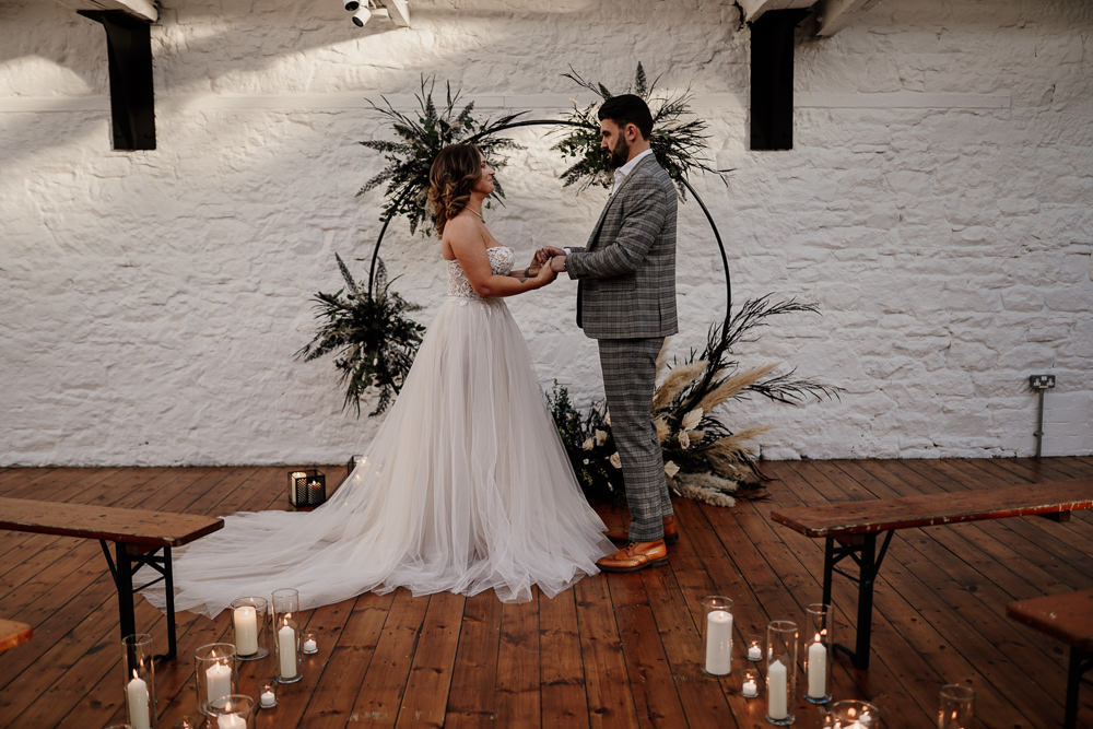 Moongate Flower Arch Candles Aisle Ceremony Pampas Grass Industrial Wedding Ideas Sam Sparks Photography