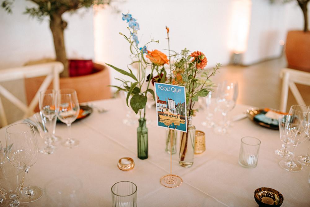 Table Flowers Bottles Centrepiece British Nigerian Wedding Andrew Brannan Photography
