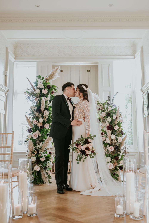 Chippenham Park Wedding Daniel Ackerley Photography Flower Arch Backdrop Ceremony